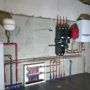 Работы по монтажу отопления в доме с насосными группами BARBERI и VAillant